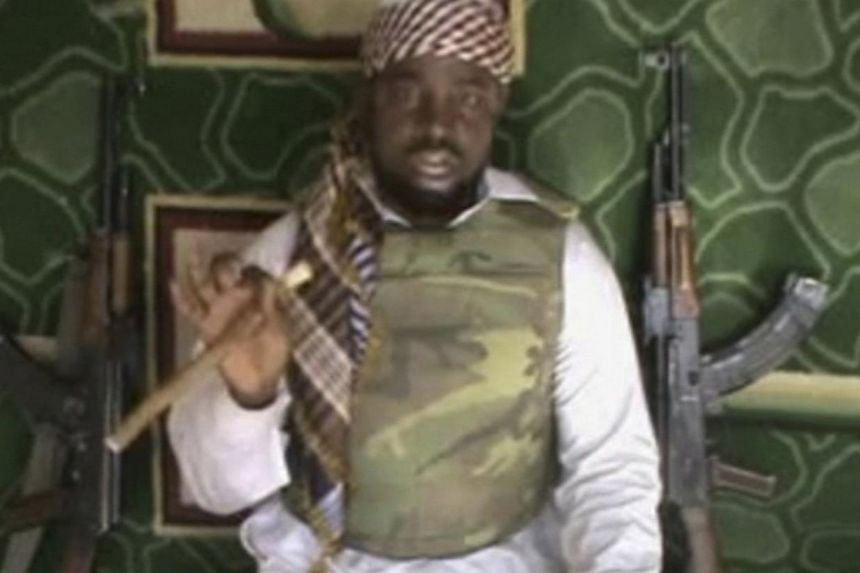 This file image made available from Wednesday, Jan 10, 2012, taken from video posted by Boko Haram sympathizers shows the leader of the radical Islamist sect Imam Abubakar Shekau. Abubakar Shekau said in a video released on Sunday that he led an Oct