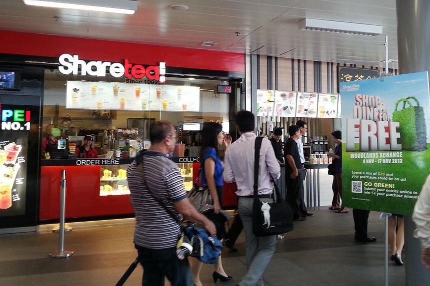 Tenants such as Share Tea and Burger King are the first shops in Singapore to be certified with the Project: Eco-Shop label, which recognises their efforts at adopting green practices. -- ST PHOTO: AUDREY TAN