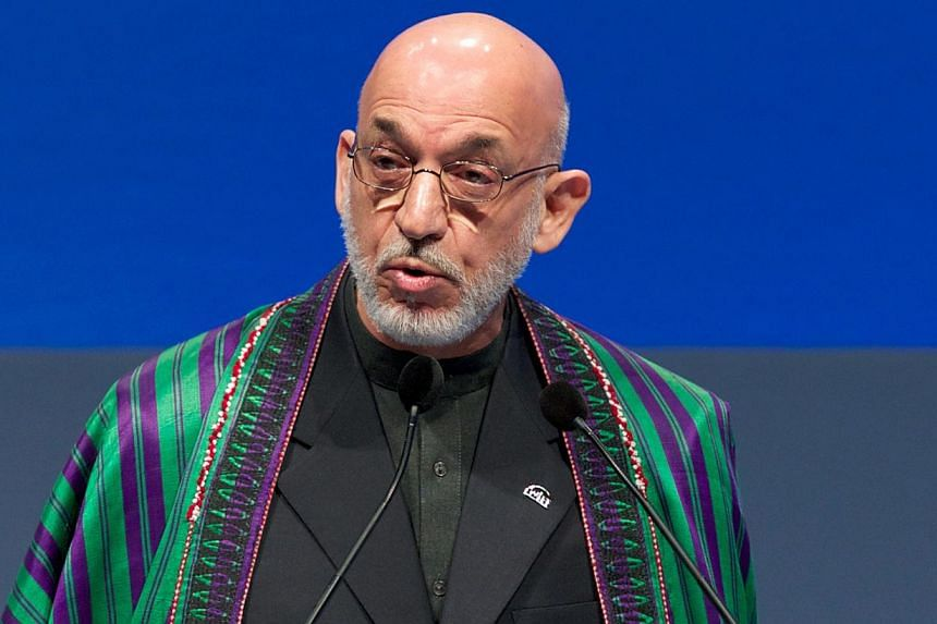 Afghan President Hamid Karzai addressing the 9th World Islamic Economic Forum in London on October 29, 2013. -- FILE PHOTO: AFP
