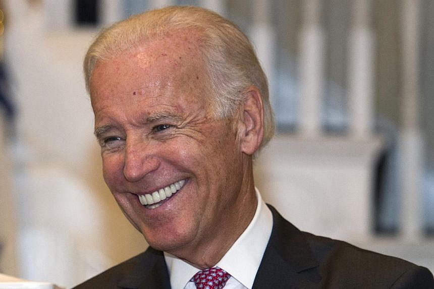 In this Sept 12, 2013 file photo, Vice-President Joe Biden smiles while hosting a reception at the Naval Observatory in Washington. Mr Biden will visit China, Japan and South Korea next month, the White House said Monday, as it seeks to ease doubts a