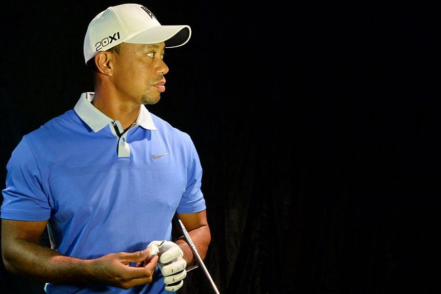 World number one golfer, Tiger Woods attends a golf clinic session with student athletes from the Singapore Sports School in Singapore on Nov 1, 2013. Woods features in a strokeplay event for the first time in six weeks at the Turkish Airlines Open s