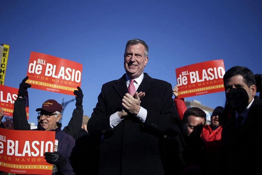 Democratic New York City mayoral candidate Bill de Blasio campaigns at a subway stop in New York on Nov 4, 2013. Millions of New Yorkers go to the polls on Nov 5 to elect a new mayor, with left-wing progressive de Blasio tipped for a landslide victor