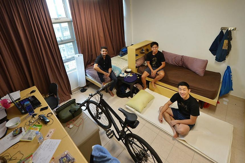 NTU students (from left) Karan Kapoor, 21, Tan Ziyang, 22, and Tuen Weng Kuen, 22, share a room on campus. Mr Tuen, who pays $40 a month to sleep on the floor of his friends' room, is one of 400 students on NTU's temporary sharing hostel scheme which