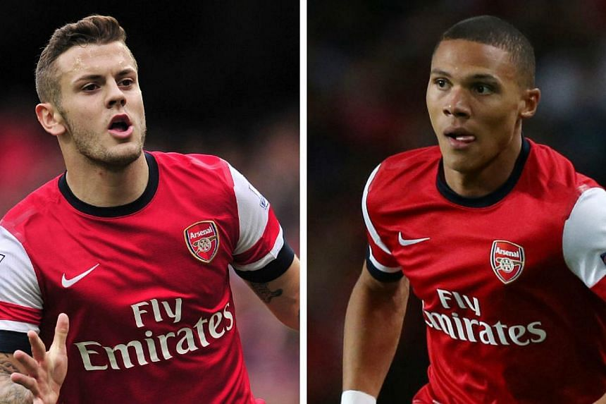 Arsenal's Jack Wilshere (left) and Kieran Gibbs are doubtful for the Champions League Group F trip to last season's runners-up Borussia Dortmund with coach Arsene Wenger eager to make amends for last month's loss to the Germans. -- FILE PHOTOS: AFP