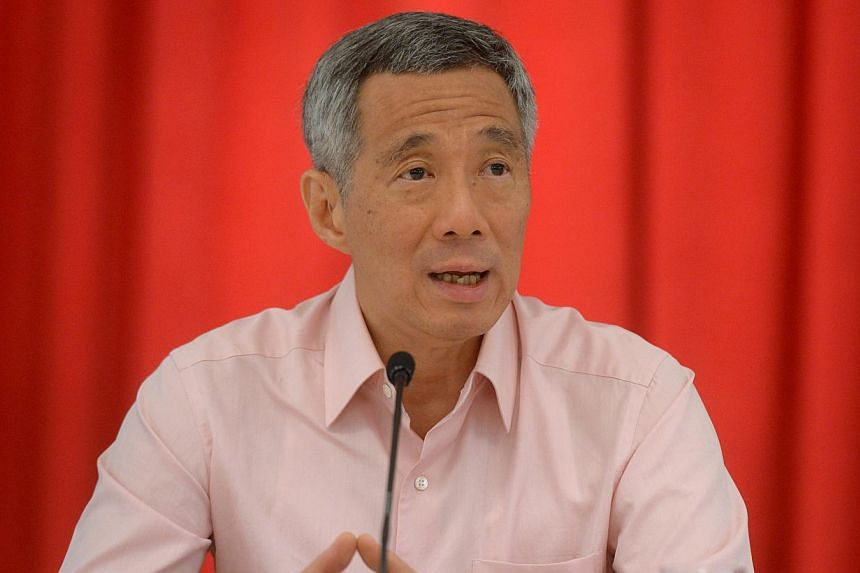 Prime Minister Lee Hsien Loong (above) met People's Action Party (PAP) Malay-Muslim Members of Parliament on Tuesday, Nov 5, 2013, to discuss the hijab issue. -- ST FILE PHOTO: JAMIE KOH