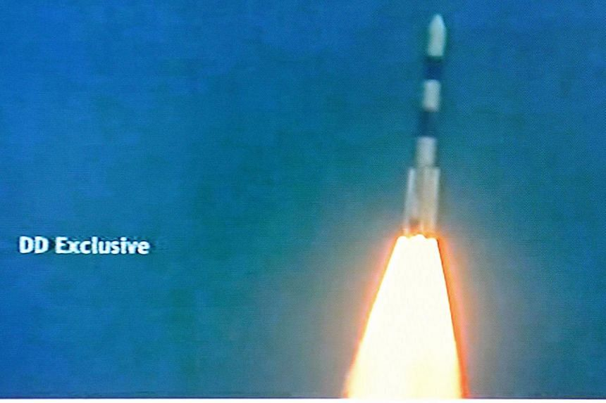 This television frame grab taken from Indian television channel NDTV, broadcasting live footage from state television Doordarshan, shows the PSLV-C25 launch vehicle carrying the Mars Orbiter probe as its payload moments after lift-off in Sriharikota