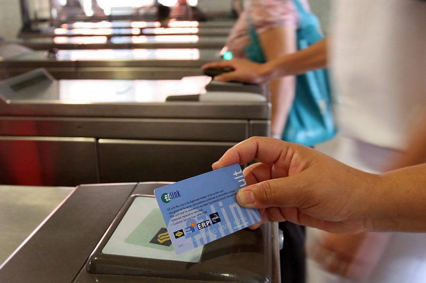 Commuters using the new Contactless ePurse Application (CEPAS)-compliant ez-link cards.A wider spectrum of commuters should get help to pay public transport fares, says the Public Transport Fare Review Mechanism Committee. -- BH FILE PHOTO:&nbs