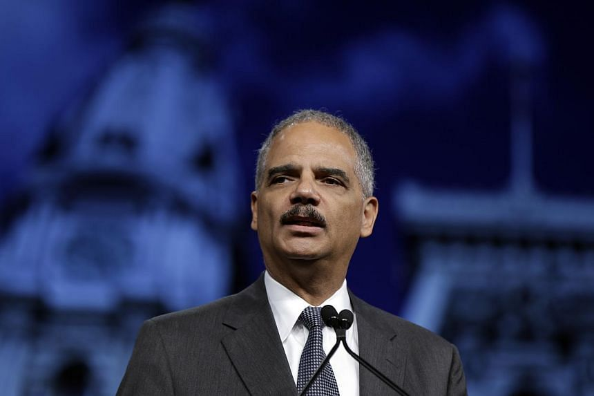Attorney-General Eric Holder speaks during the Annual International Association of Chiefs of Police Conference, on Oct 21, 2013, at the Pennsylvania Convention Center in Philadelphia. Mr Holder said on Monday that accused September 11 mastermind Khal
