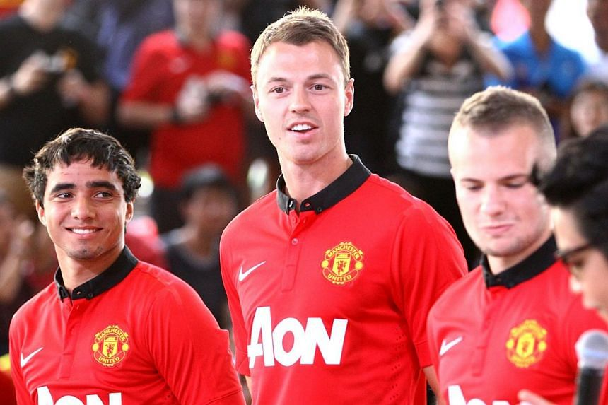 Manchester United players (from left) Rafael da Silva, Jonny Evans and Tom Cleverley being introduced in Bangkok, Thailand on Jul 12, 2013. Bothdefenders Evans and Rafael will miss Tuesday's Champions League match at Real Sociedad due to injury