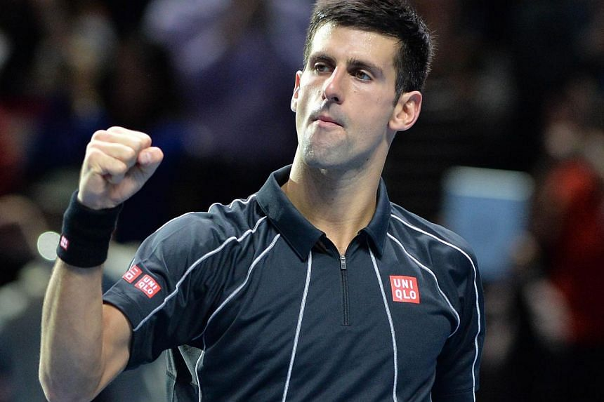 Serbia's Novak Djokovic celebrates beating Switzerland's Roger Federer in their group B singles match in the round robin stage on the second day of the ATP World Tour Finals tennis tournament in London on November 5, 2013.Novak Djokovic got the