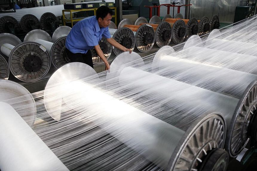 IN SINGAPORE: Among the encouraging signs were a PMI reading of 51 for the electronics sector (above), in a ninth straight month of expansion. New factory orders and new export orders also saw higher readings last month from September, as did factory