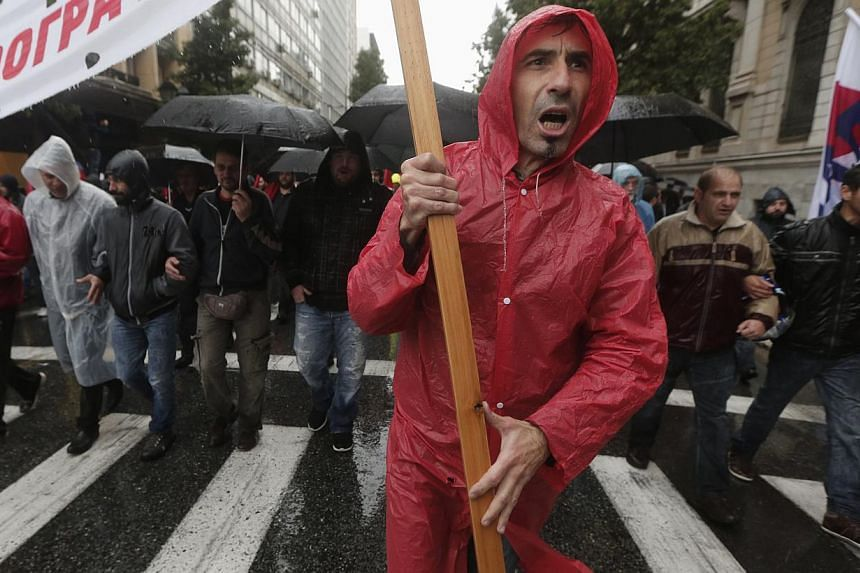 Protesters from the Communist-affiliated trade union Pame march during a general 24-hour labour strike in Athens on Wednesday, Nov 6, 2013.A general strike hit Greece on Wednesday, paralysing public services and disrupting transport as EU-IMF a