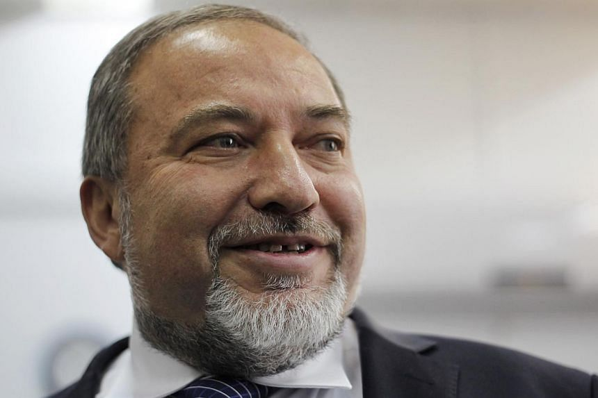 Former Israeli foreign minister Avigdor Lieberman (above) was acquitted of corruption charges on Wednesday, Nov 6, 2013, a verdict that paves the way for the far-right politician to return to the post. -- FILE PHOTO: AP
