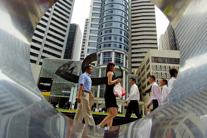 Business people walk through Raffles Place, Singapore's central business district, on Tuesday, Feb 13, 2007.Twoseparate surveys - by human resource consulting firms ECA International and Towers Watson - found that companies here are likel