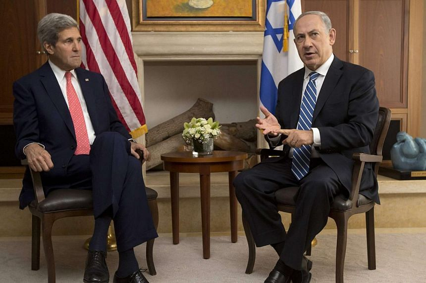 US Secretary of State John Kerry (left) was meeting with Israel's Prime Minister Benjamin Netanyahu in Jerusalem on Wednesday, Nov 6, 2013,just hours after the Palestinians threatened to bolt the peace talks over settlement building. -- PHOTO: