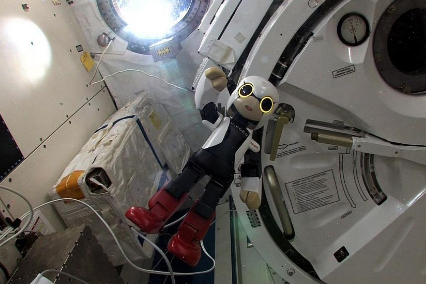 This handout picture received from Kibo Robot Project on Wednesday, Nov 6, 2013, shows humanoid robot Kirobo in the International Space Station (ISS). The world's first robot astronaut is pining for a conversation partner as he waits for Japanes