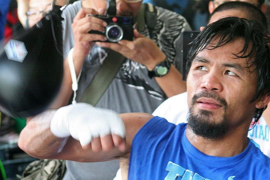Philippine boxing great Manny Pacquiao (right) said on Wednesday, Nov 6, 2013, he was expecting to defeat American Brandon Rios in Macau later this month, but insisted if he did lose he would not retire. -- FILE PHOTO: AFP