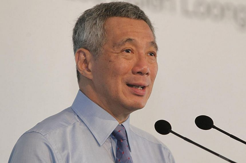 "Singapore will ""spare no effort"" to track down and bring to justice those who threaten to attack the Republic's computer networks, said Prime Minister Lee Hsien Loong (above) on Wednesday, Nov 6, 2013. -- ST PHOTO: MARK CHEONG"