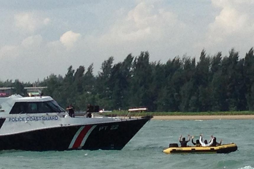 Police Coast Guard (left) stopping a terrorist speedboat from approaching Tanah Merah Ferry Terminal. This was part of a counter-terrorist sea deployment exercise on Nov 6, as part of the government-wide Exercise Highcrest. -- ST PHOTO: YEO SAM JO