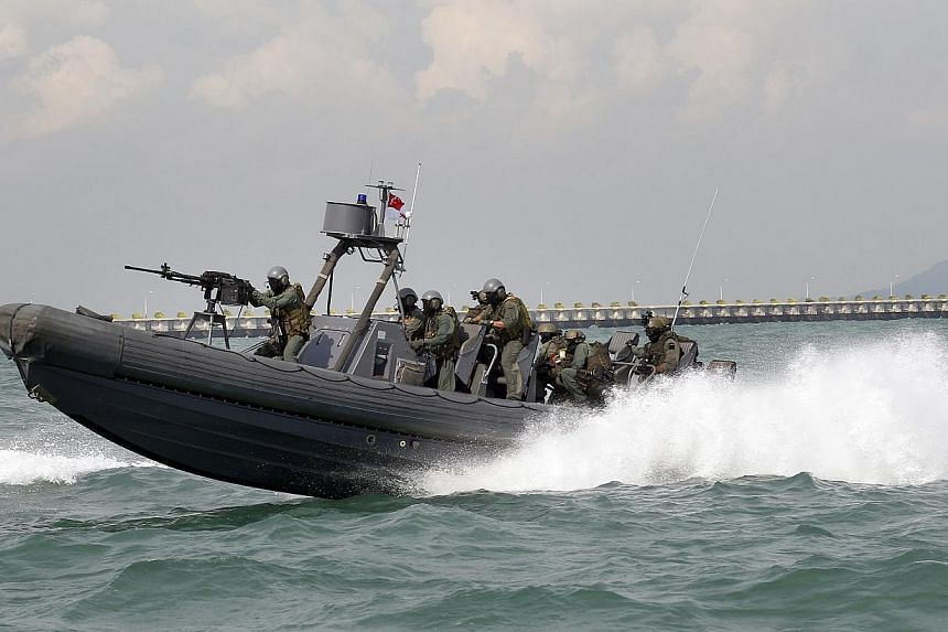 A government-wide exercise to test Singapore's counter-terrorist capabilities both on land and sea culminated on Wednesday with the simulation of a multi-pronged terrorist attack.-- ST PHOTO:CHEW SENG KIM