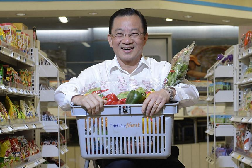 Mr Seah Kian Peng (above), chief executive of the NTUC FairPrice Co-operative, has been re-elected for a new four-year term to the global Board of the International Co-operative Alliance (ICA). -- ST FILE PHOTO:DESMOND LIM
