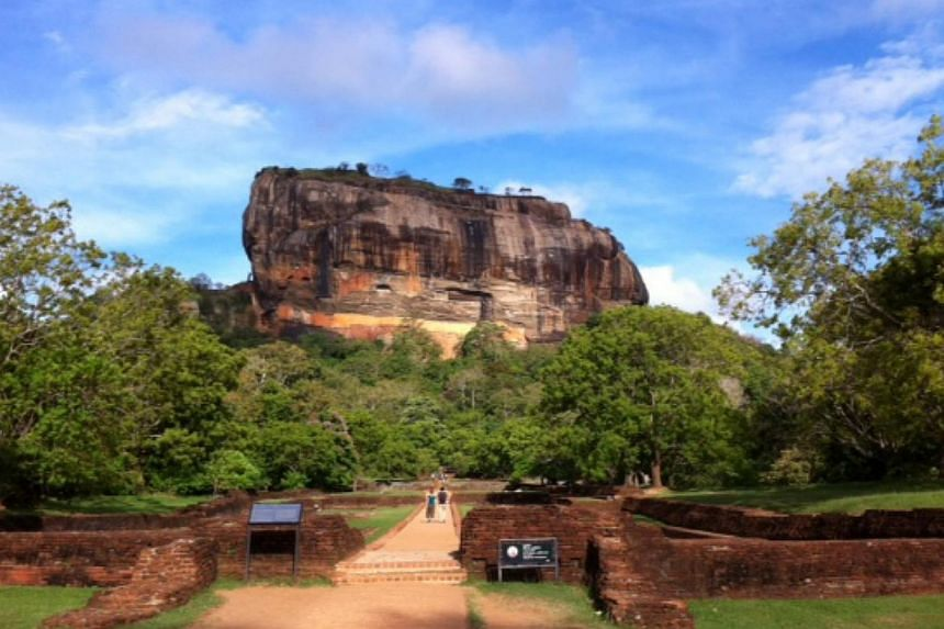 The stunning Sigiriya rock fortress is one of Sri Lanka's eight Unesco-listed World Heritage Sites. The unusual outcrop that rises 200m from a dense scrub jungle used to be the site of King Kashyapa's palace in the 5th century. --Copyright: CHE
