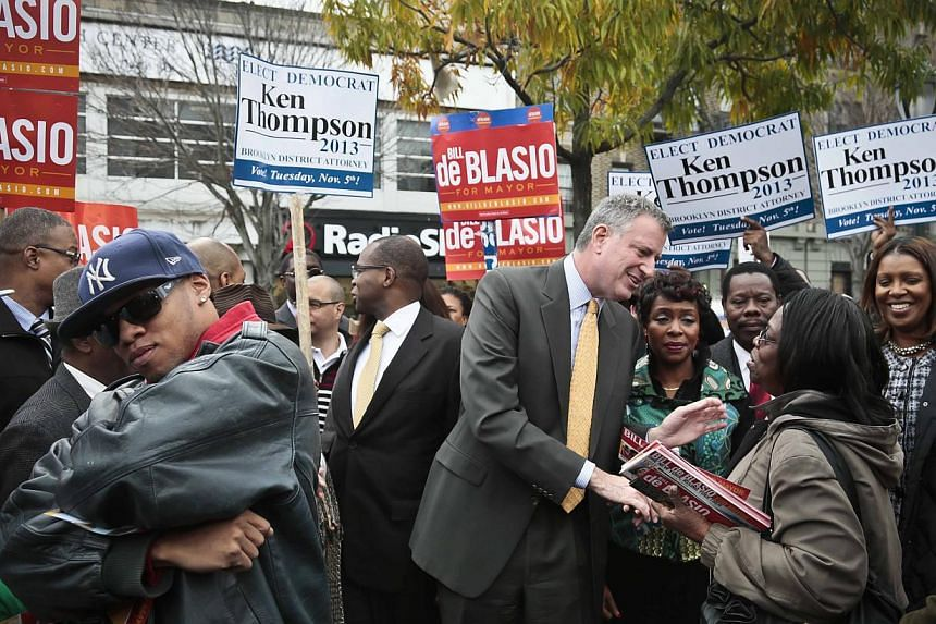Democratic mayoral candidate Bill de Blasio, fifth from right, accompanied by other party candidates for electoral office including, Mr Ken Thompson, centre, candidate for Brooklyn district attorney, and Ms Letitia James, far right, candidate for pub