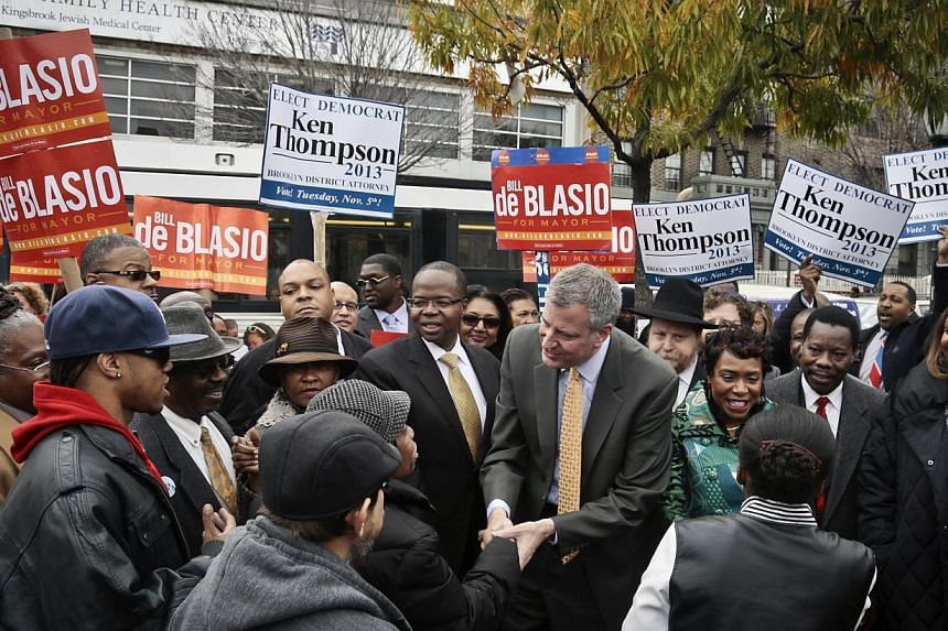 Democratic mayoral candidate Bill de Blasio, centre, meets with potential voters on Tuesday, Nov 5, 2013, in the Crown Heights section of Brooklyn, New York. Mr De Blasio has been elected mayor of New York, replacing billionaire Michael Bloomberg, US