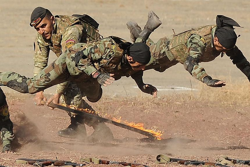 Armenian military scouts demonstrate their skill during a performance to mark the annual anniversary of the Armenian Armed Forces reconnaissance troops formation, some 25km outside in Yerevan on Nov 5, 2013. -- FILE PHOTO: AFP