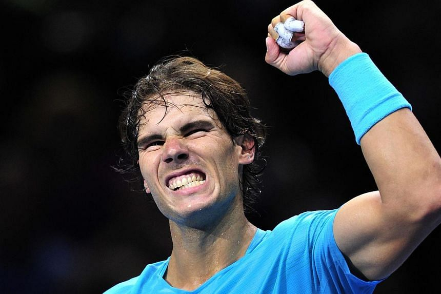 Spain's Rafael Nadal celebrates beating Spain's David Ferrer during their group A singles match in the round robin stage on the second day of the ATP World Tour Finals tennis tournament in London on Nov 5, 2013. Nadal won 6-3, 6-2. -- PHOTO: AFP