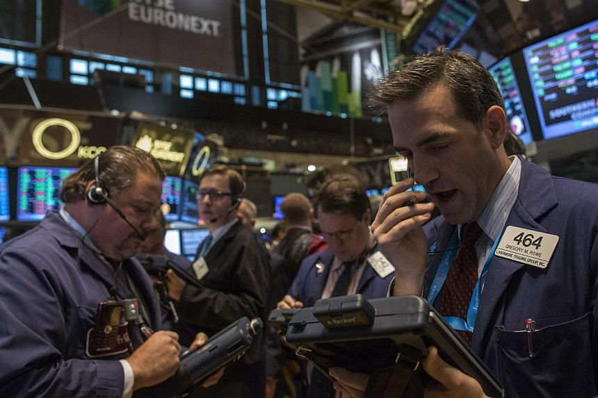 Traders work on the floor of the New York Stock Exchange.United States (US) stocks seesawed between modest gains and losses on Tuesday following two days of gains on Wall Street as investors weighed the implications of strong economic data for