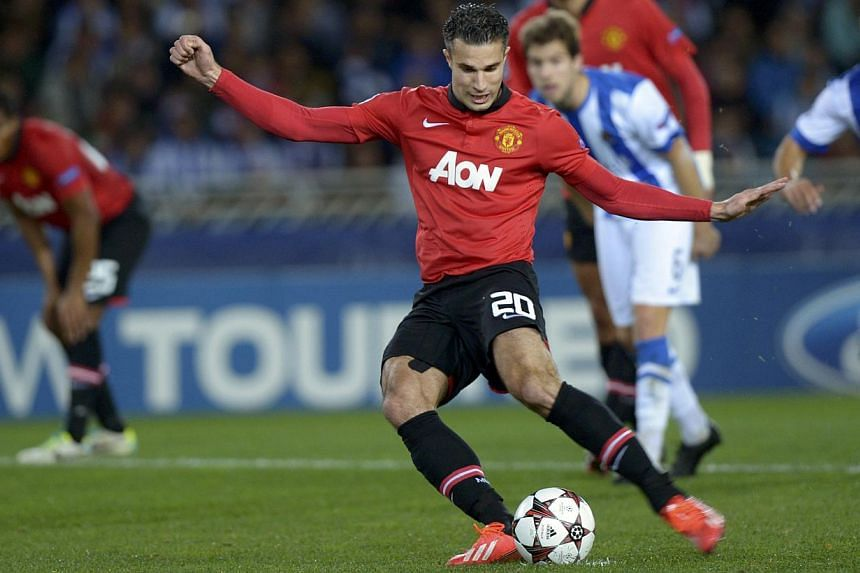 Manchester United's Robin van Persie kicks the ball to miss a penalty shot during their Champions League soccer match against Real Sociedad at Anoeta stadium in San Sebastian, northern Spain, on Nov 5, 2013.United missed a chance to move to the