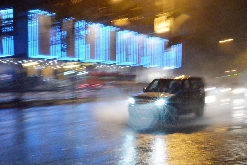 A car driving through water on a rainy night.More accidents occur on Singapore roads on stormy days and with the monsoon season in full swing, road safety experts are advising motorists to take extra care. -- ST FLE PHOTO:ALPHONSUS CHERN