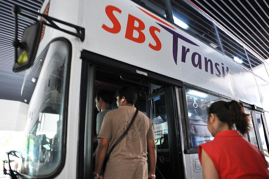 Passengers boarding a SBS Transit bus. While transport experts hail the recommendations by a fare review committee as progressive, they say Singapore should shift to a regime where the interests of transport operators and commuters need not