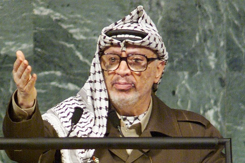 A September 28, 1998 file photo shows Palestinian leader Yasser Arafat addressing the 53rd session of the United Nations General Assembly 28 September at the UN in New York. Swiss scientists have concluded Palestinian leader Yasser Arafat is lik