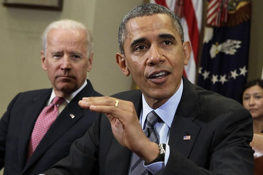 US President Barack Obama (right) speaks next to Vice President Joe Biden during a meeting with business leaders to discuss immigration at the White House in Washington Nov 5, 2013.Mr Obama and Mr Biden met more than a dozen Senate Democrats on