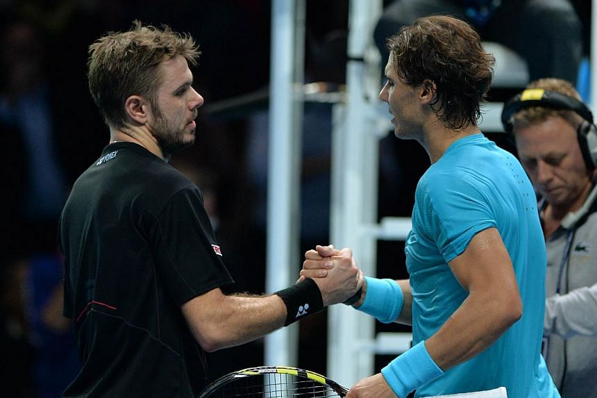 Spain's Rafael Nadal (right) shakes hands with Switzerland's Stanislas Wawrinka (left) after winning their group A singles match in the round robin stage on the third day of the ATP World Tour Finals tennis tournament in London on Nov 6, 2013. 2