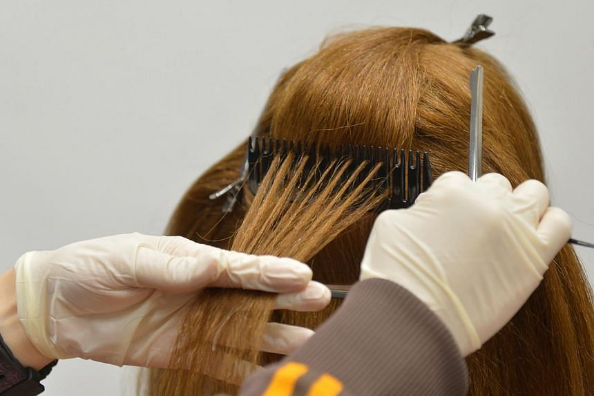 A CNB officer (picture below left) demonstrating on a mannequin how a hair sample is collected for testing purposes. The hair samples (above picture) are later wrapped in aluminium foil at the roots and then inserted into a tamper-proof exhibit bag i