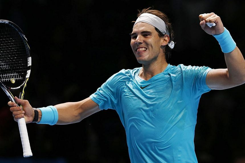 Rafael Nadal of Spain celebrates after winning his singles tennis match against Stanislas Wawrinka of Switzerland at the ATP World Tour Finals at the O2 Arena in London on Wednesday, Nov 6, 2013.Nadal believes his return to the top of the world