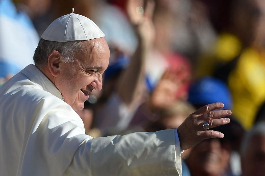 Pope Francis (above) will receive Russian President Vladimir Putin on Nov 25, the Vatican said on Thursday, Nov 6, 2013, as the Roman Catholic Church seeks to improve ties with the Russian Orthodox Church. -- PHOTO: AFP
