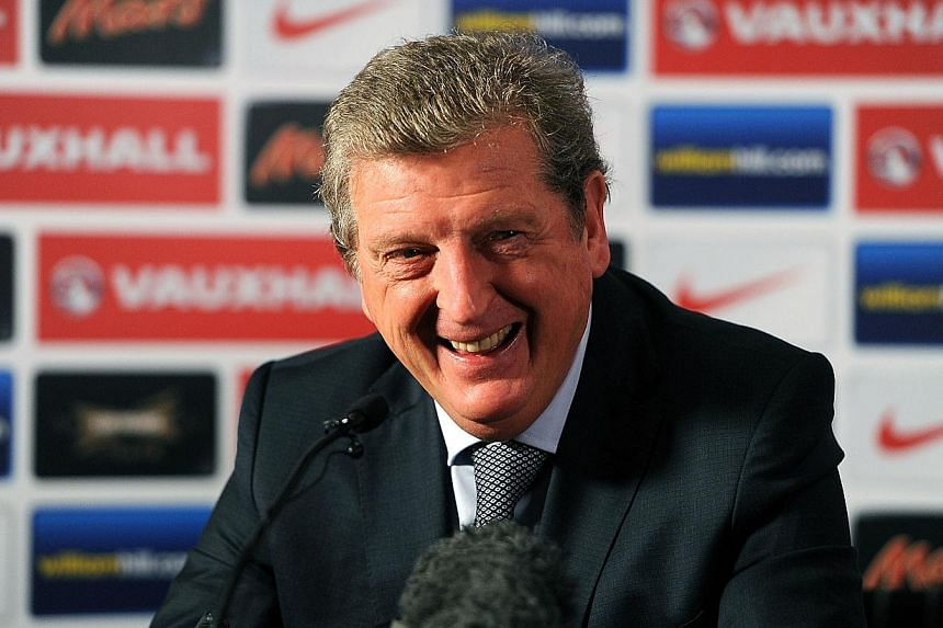 England manager Roy Hodgson (above) on Thursday, Nov 7, 2013, said that he did not regret making a controversial comment about winger Andros Townsend that partially overshadowed his side's qualification for the World Cup. -- FILE PHOTO: AFP