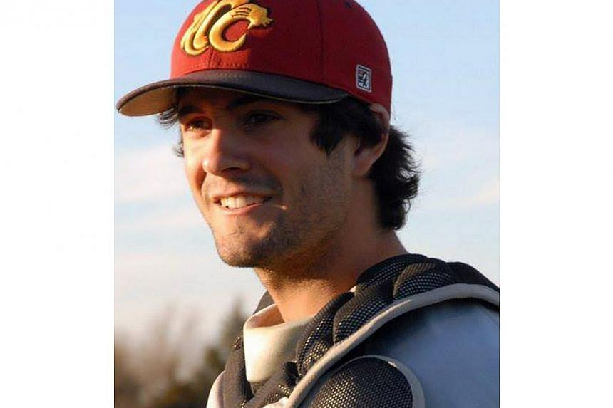"""In this undated file photo provided by the Essendon Baseball Club, player Chris Lane wears his baseball equipment, in Australia. The Australian baseball player out for a jog in an Oklahoma neighbourhood was shot and killed by three """"bored"""" teenag"""