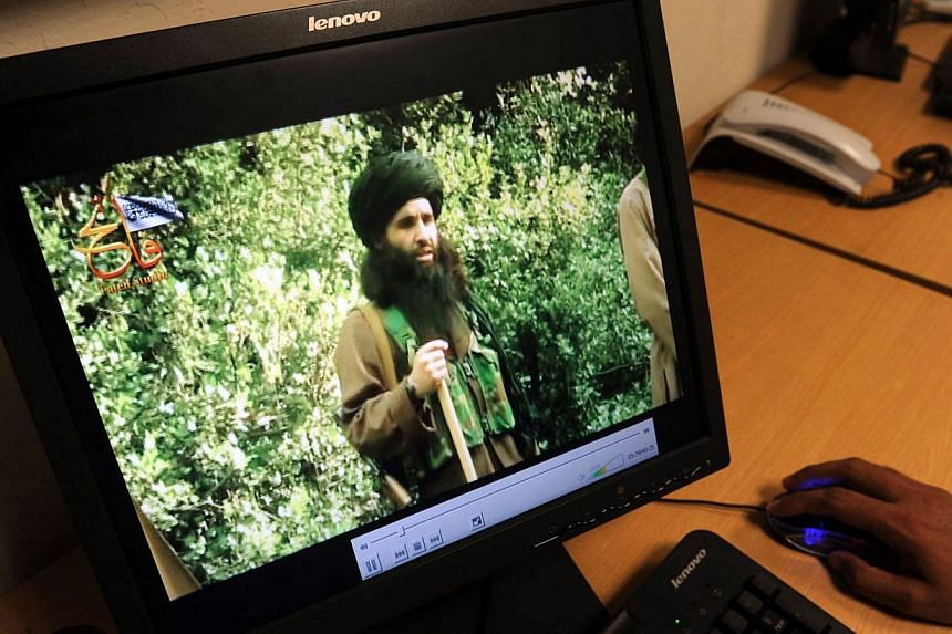 In this photograph taken on July 23, 2010, a Pakistani journalist watches a newly released video of radical Pakistani cleric Maulana Fazlullah in Peshawar. The Pakistani Taleban on November 7, 2013, elected Maulana Fazlullah as their new chief follow
