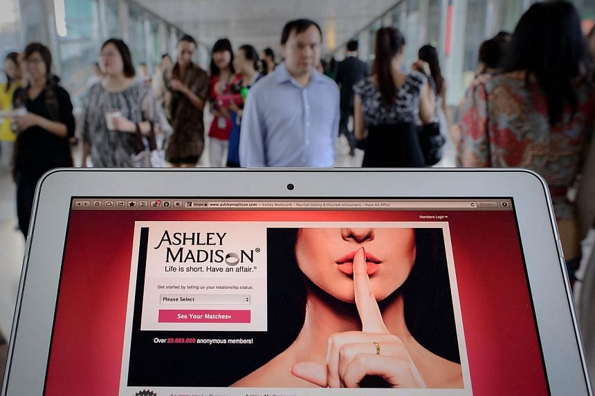 This photo illustration taken on Aug 20, 2013, shows the homepage of the Ashley Madison dating website displayed on a laptop in Hong Kong. The extra-marital dating website is set to launch a Singapore edition this month despite widespread objections.