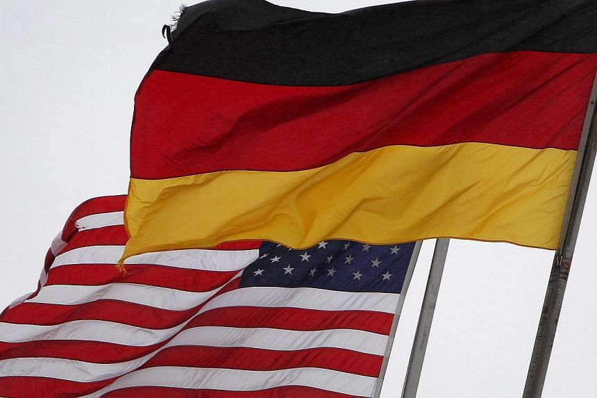 The German and the United States (US) flags fly at the US Airbase in Ramstein, southern Germany, on Nov 6, 2013. Revelations of US global spying have raised digital privacy protection questions the United Nations needs to address, Germany and Br