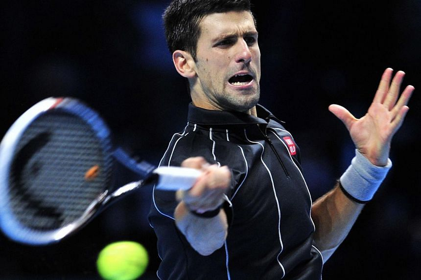 Serbia's Novak Djokovic returns against Argentina's Juan Martin Del Potro during their group B singles match in the round robin stage on the fourth day of the ATP World Tour Finals tennis tournament in London on Nov 7, 2013. Defending champion D