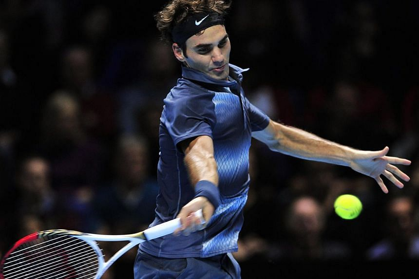 Switzerland's Roger Federer returns against France's Richard Gasquet during their group B singles match in the round robin stage on the fourth day of the ATP World Tour Finals tennis tournament in London on Nov 7, 2013.Federer called for more d