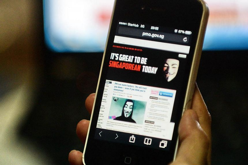 Activist hacker group Anonymous is seen through the internet government website of Singapore Prime Minister Office circulated online on a smartphone in Singapore on Thursday, Nov 7, 2013.An unusually high amount of traffic to many Government si