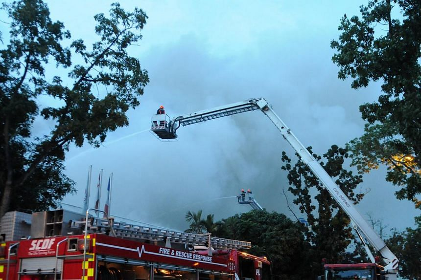SCDF mitigating the fire using the aerial platform monitor.-- PHOTO:SINGAPORE CIVIL DEFENCE FORCE