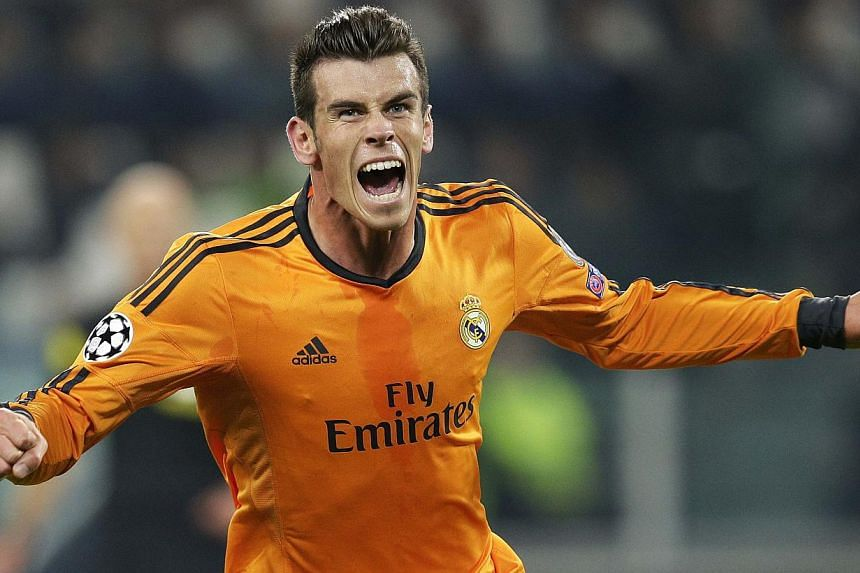 Real Madrid winger Gareth Bale celebrates after scoring against Juventus during their Champions League football match at Juventus stadium on Tuesday, Nov 5, 2013. Bale is looking to build on by far his best week since arriving in the Spanis